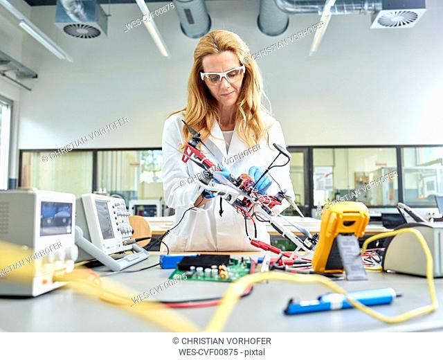 Female technician working in research laboratory, developing drone