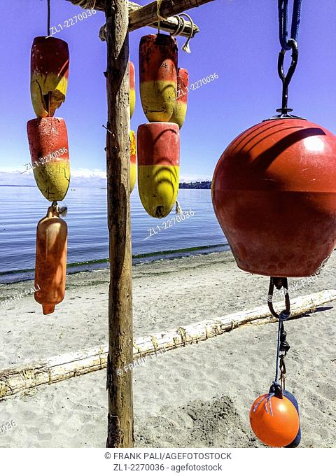 Colourful floats hanging on beach in Victoria British Columbia