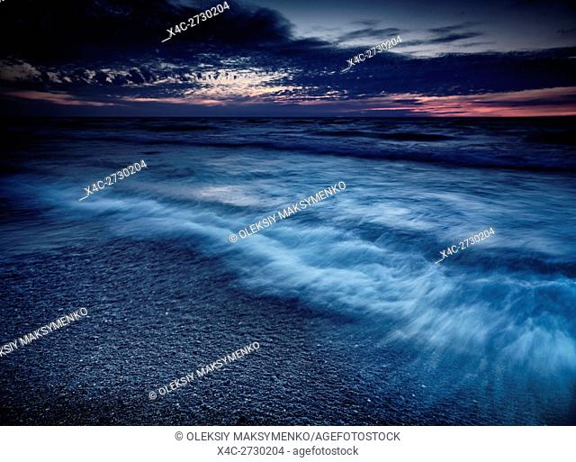 Beautiful dramatic stormy twilight nature scenery of lake Huron, Grand Bend, Ontario, Canada