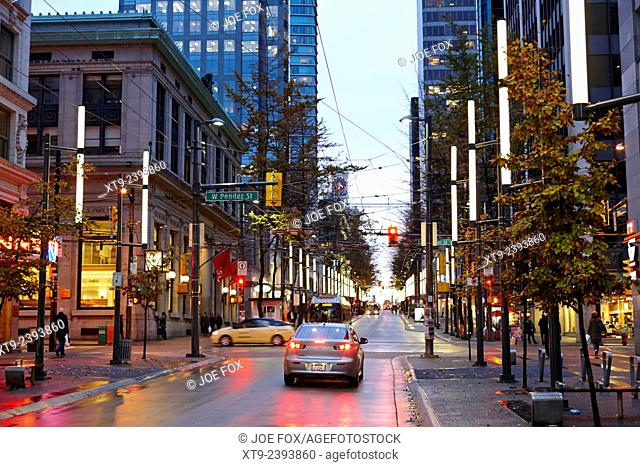 junction of west pender street and granville downtown city at night Vancouver BC Canada