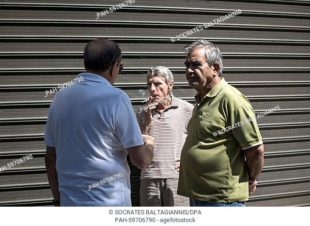 Greek pensioners wait outside of a bank to get their pensions in Athens, Greece, 01 July 2015. Greece's government has made new concessions in talks with its...