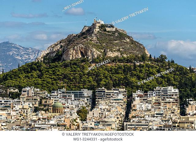 Cityscape of Athens and Lycabettus Hill, also known as Lykabettos, Lycabettos or Lykavittos. It is a Cretaceous limestone hill in Athens, Greece
