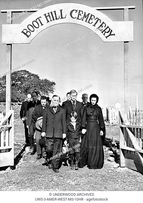 Hollywood, California: c. 1952.Mourners walking out of the Boot Hill Cemetary in a Western movie scene