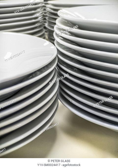 Stacks of white dinner plates
