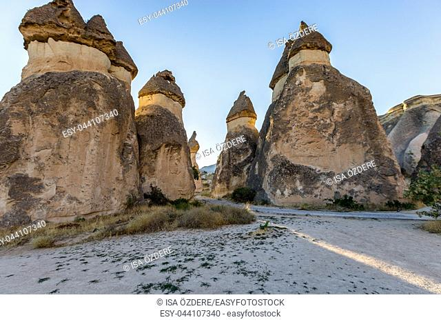 Fairy tale chimneys in Cappadocia, tourist attraction places to fly with hot air balloons. Goreme, Cappadocia, Turkey