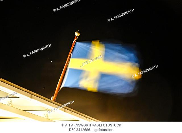 Stockholm, Sweden A Swedish flag blowing in the wind on a Baltic Sea ferry