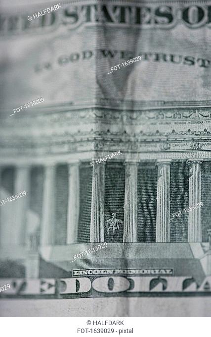 Full frame shot of US five dollar bill with text