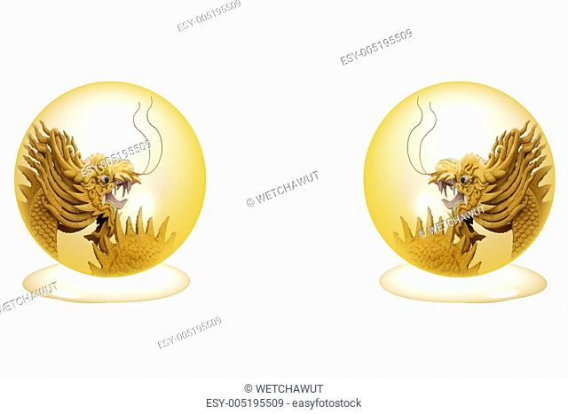 Golden Dragon in crystal ball isolated on a white background
