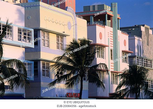 South Beach. Ocean Drive. Art Deco hotels and palm trees seen in early morning light