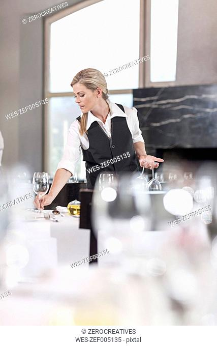 Restaurant staff setting tables