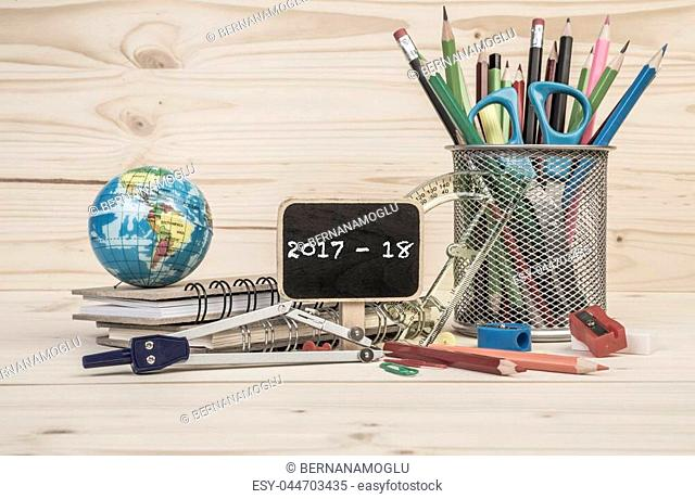 back to school template with multiple stationary on wooden table
