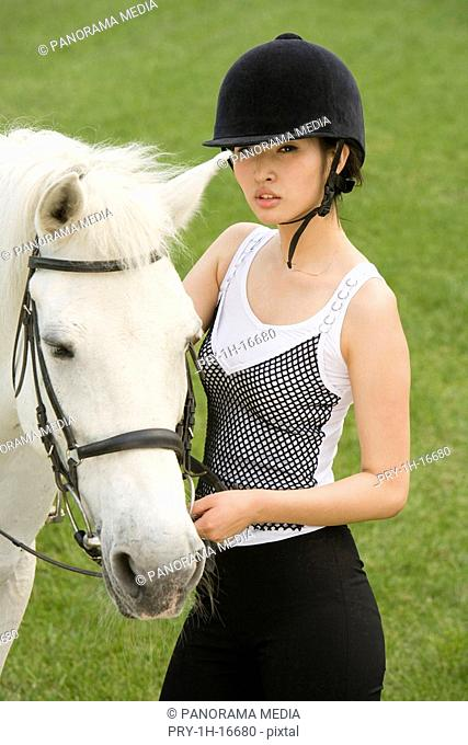 a female horsemanship athlete and her horse