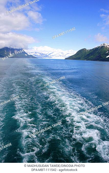 Distance view of Hubbard glacier; waves created by cruise ship ; the longest tidewater glacier in Alaska; Saint Elias  national park ; disenchantment bay ;...