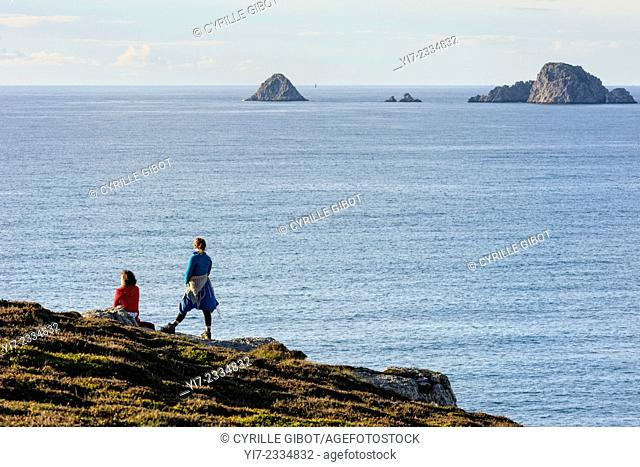 Two female hikers look out to sea, Crozon Peninsula, Finistere, Brittany, France