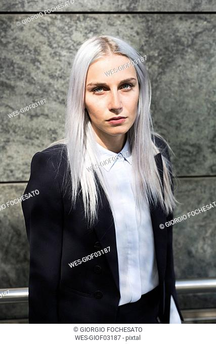 Portrait of serious young businesswoman outdoors