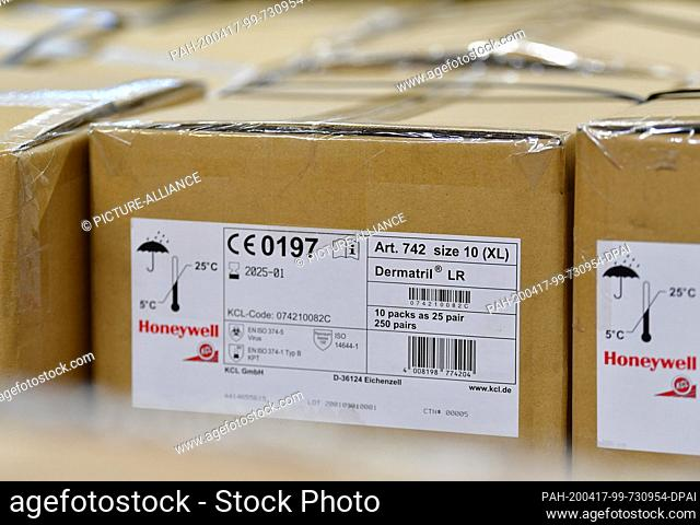 16 April 2020, Brandenburg, Großbeeren: A package from Honeywell with disposable Dermatril gloves is available from the logistics service provider Rhenus...