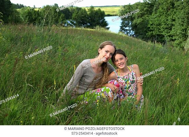 Woman and daughter in the grass, Kirillovka, Togliatti, Samara Region, Russia