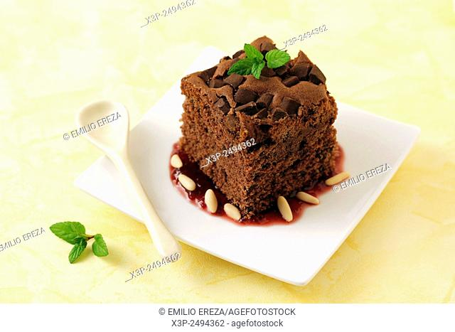 Brownie with cherries jam and pine nuts