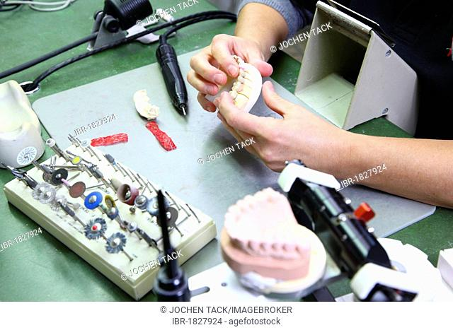 Dental laboratory, manufacture of a dental prosthesis by a master craftsman, matching a ceramic-veneered dental bridge