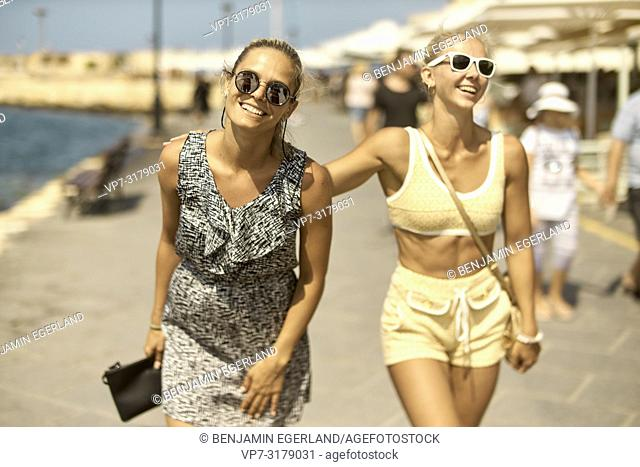 two women walking in Chania, Crete, Greece