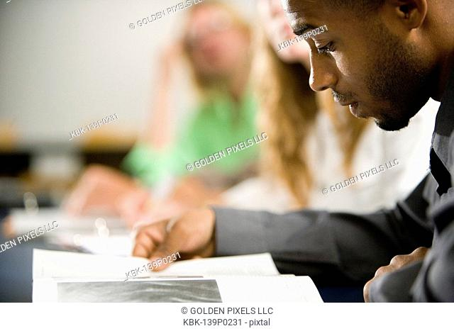 Close-up of a student reading