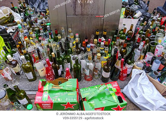 Lots of empty glass bottles in a glass container for recycling. Bordeaux, Gironde. Aquitaine region. France Europe