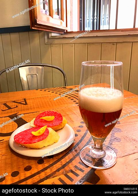 Glass of beer with tapa. Spain