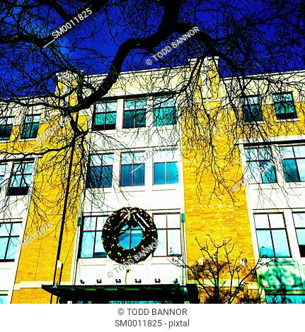 Large Christmas wreath hung on building