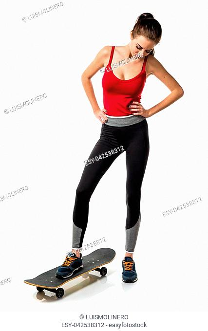 Pretty sport woman with skate