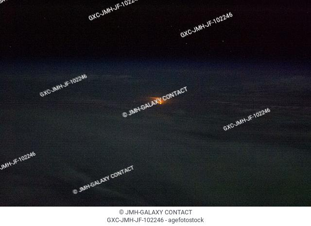 One of the Expedition 35 crew members aboard the Earth-orbiting International Space Station took this photo which was part of a series documenting the launch of...