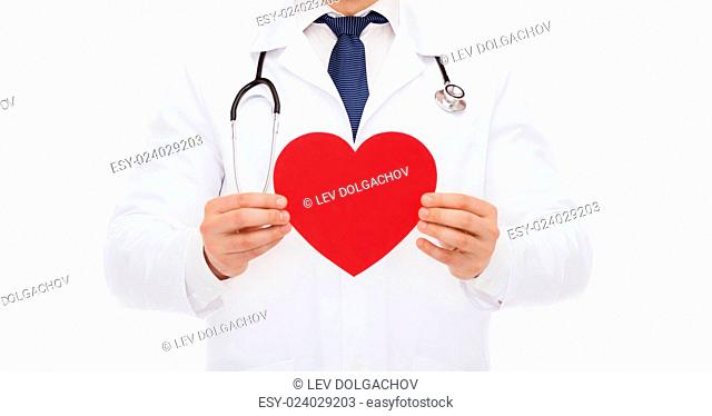 medicine, profession, and healthcare concept - male doctor with red heart and stethoscope