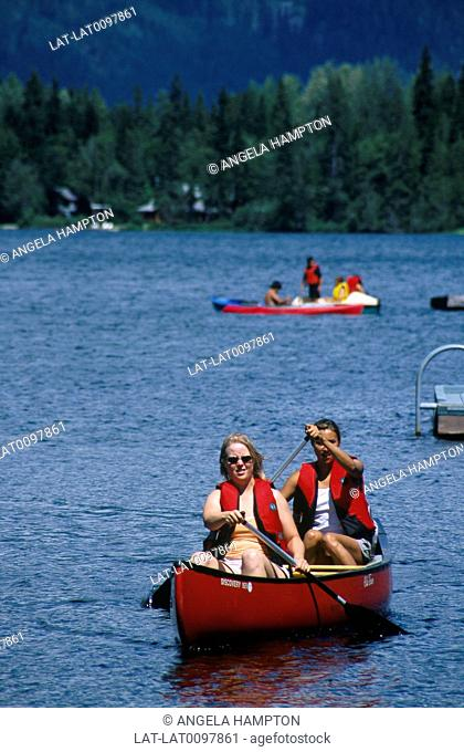 Garibaldi Point. Near Whistler. Boat hire. Canoe. Couple with paddles