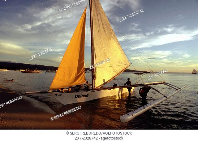 Boats to practice sailing. White beach. Boracay. Philippines. Boracay is a small island in the Philippines located approximately 315km (196mi) south of...