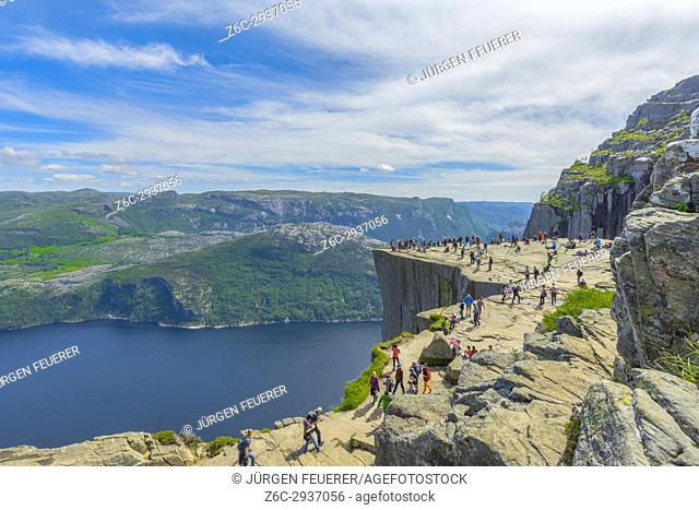 Tourists hiking to the cliff Preikestolen on the Lysefjorden, near Forsand in Norway, Scandinavia