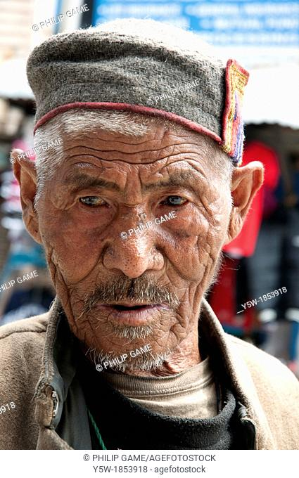 Local man in Old Manali, Himachal Pradesh  He wears the traditional cap of the region