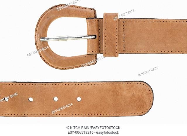 A close up shot of a belt buckle