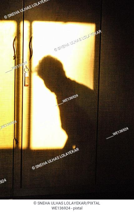 Human shadow on cupboard,poona,Maharashtra,India