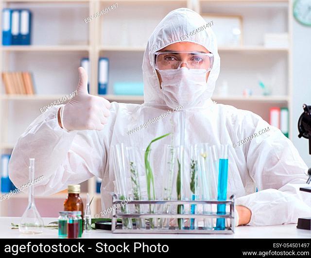 The biotechnology scientist chemist working in lab