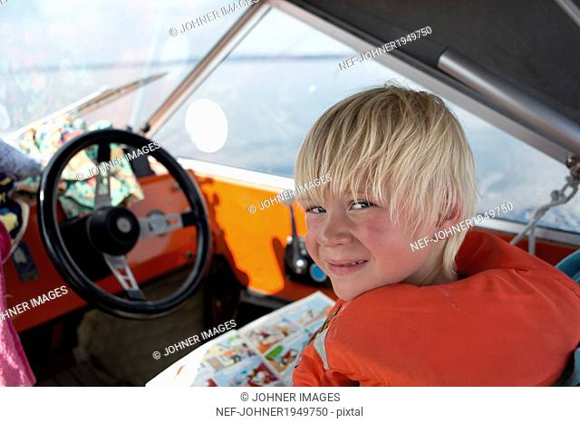 Boy on boat, Siljan, Dalarna, Sweden
