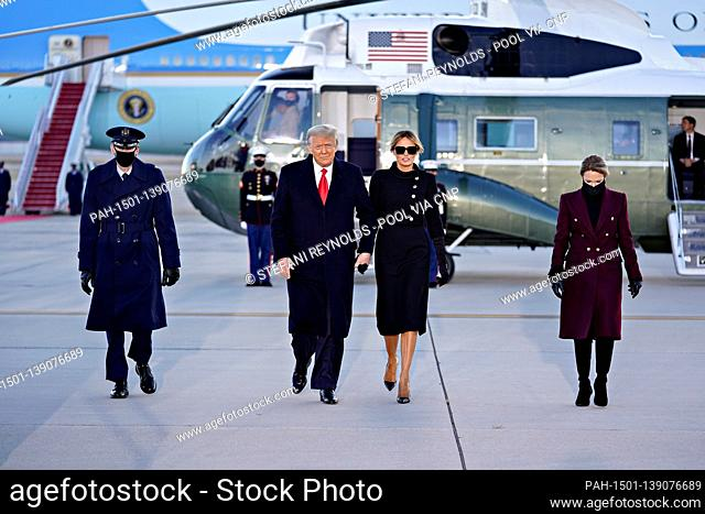 U.S. President Donald Trump, center left, and U.S. First Lady Melania Trump arrive to a farewell ceremony at Joint Base Andrews, Maryland, U.S