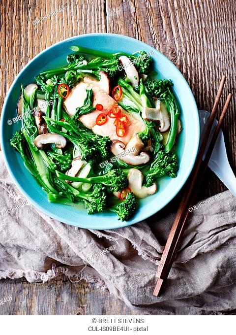 Salmon and miso soup with asian greens, overhead view