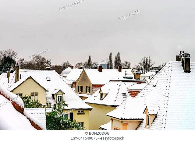 Snow-covered roors of old quarter in Strasbourg after snowfall, France