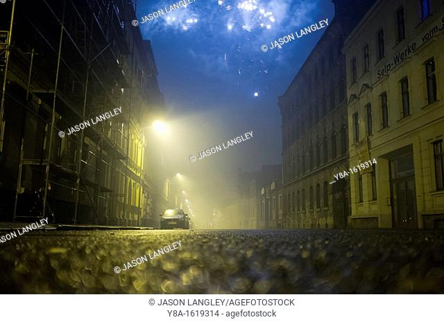 Fireworks in the sky over an empty street on New Year's Eve, Leipzig, Germany, Europe