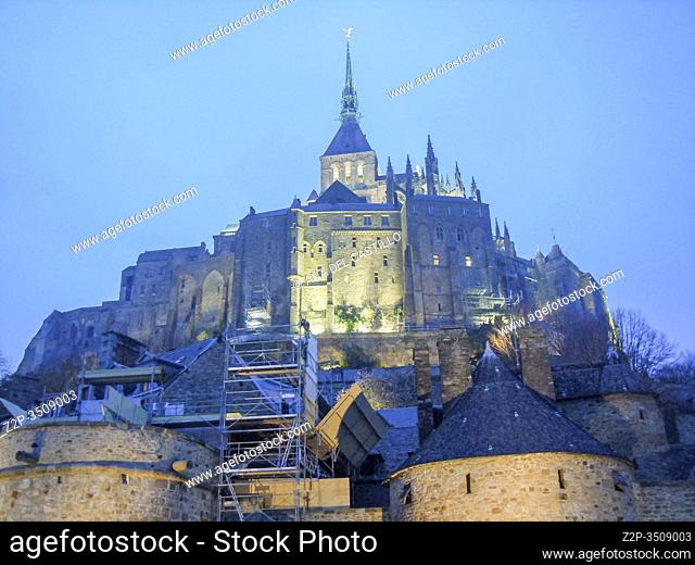 Mont Saint Michel by dusk, Normandy, France.The view on St Michael Mount by twilight