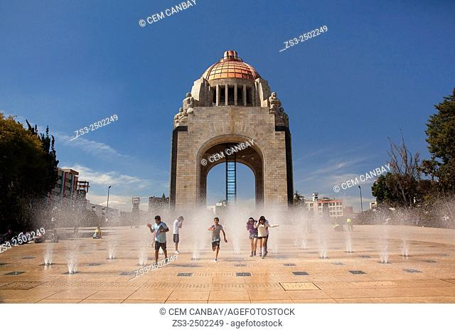Students playing with the water near the Monument dedicated to the Mexican Revolution (Monumento dedicado a la Revolución Mexicana) at night, Mexico City