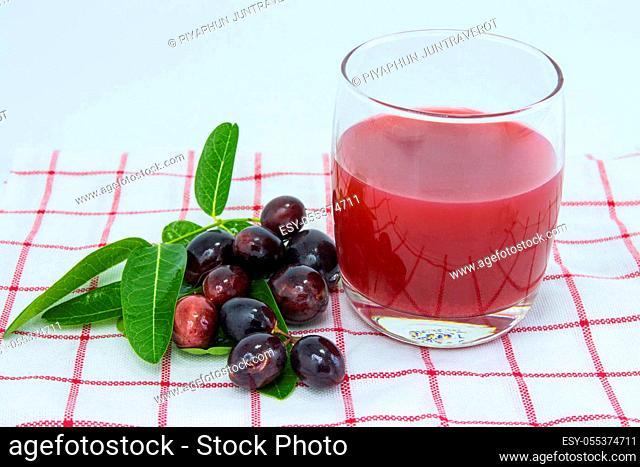 fresh Carissa carandas glass of juice with Carissa carandas fruits and Healthy drinks concept.