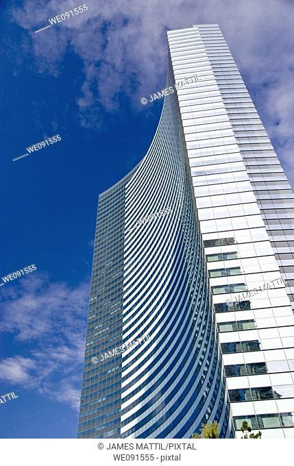 A high-rise hotel glistens against blue sky at CityCenter, Las Vegas, Nevada