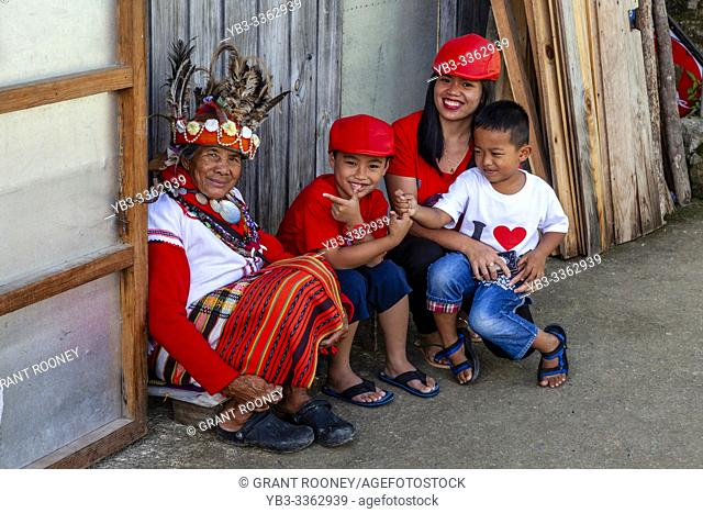 A Filipino Family Pose With An Ifugao Tribal Woman, Banaue, Luzon, The philippines