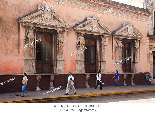 People walking in front of the historic building of Museo Casa Montejo museum at Central Plaza- Zocalo, Merida, Yucatan Province, Mexico, Central America