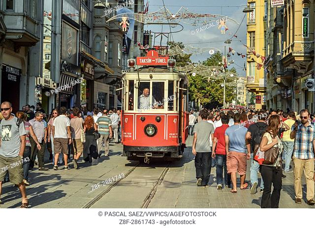 Partial view of Istiklal street, with the historic streetcar approaching